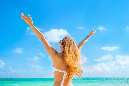 Happy girl woman on beach enjoying nature ocean