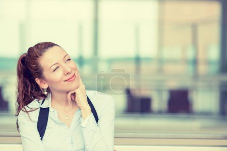 Photo for Portrait happy young woman thinking dreaming has many ideas looking up isolated office windows background. Positive human face expression emotion feeling reaction. Decision making process concept - Royalty Free Image