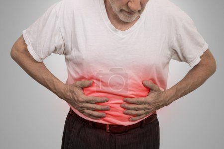 Stomach ache, man placing hands on the abdomen