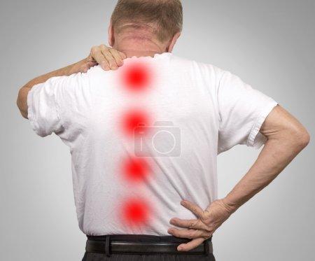 Senior elderly man with backache
