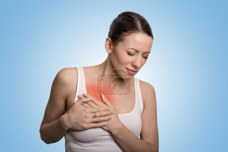 Young woman with chest breast pain colored in red