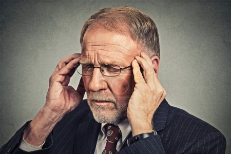 Stressed senior man looking down sad depressed, alone, disappointed