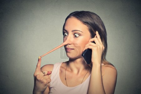 Liar woman with long nose talking on mobile phone