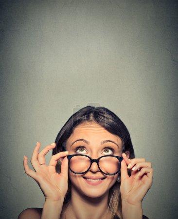 Smiling Woman Wearing Eyeglasses with Black Frames Looking Up