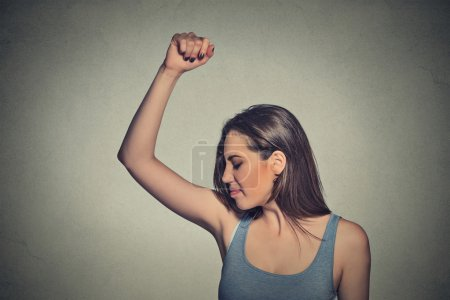 woman, smelling, sniffing her wet armpit, something stinks