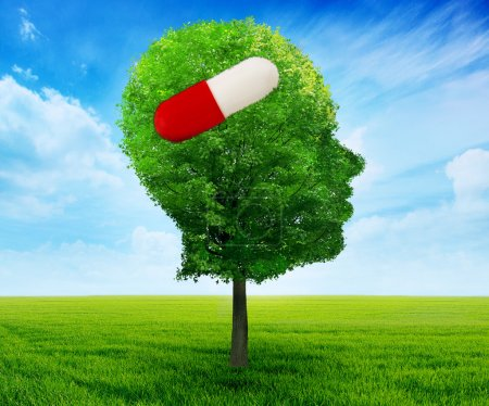 Tree in a shape of side profile human head with pill