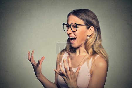 Photo for Angry frustrated young woman screaming - Royalty Free Image