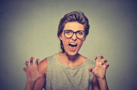 Photo for Angry young woman with glasses screaming - Royalty Free Image