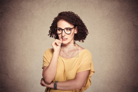 Photo for Closeup portrait nervous looking woman biting her fingernails craving something anxious isolated grey wall background. Negative human emotion facial expression body language perception - Royalty Free Image