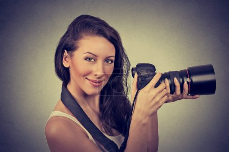 Photo for Professional female photographer holding digital camera and smilin - Royalty Free Image
