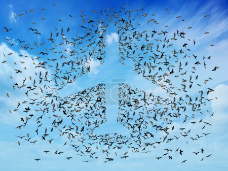 Air travel concept. Flock of flying birds organize...