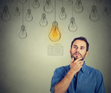 man looking up with idea light bulb above head