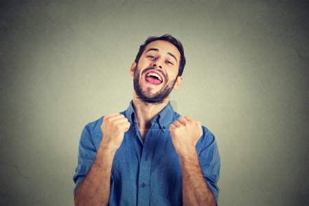 happy successful student, business man winning, fists pumped celebrating success
