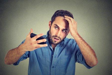 portrait, shocked man feeling head, surprised he is losing hair, receding hairline