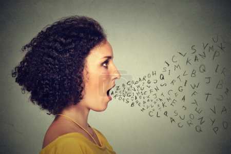Woman talking with alphabet letters coming out of her mouth. Communication intelligence concept