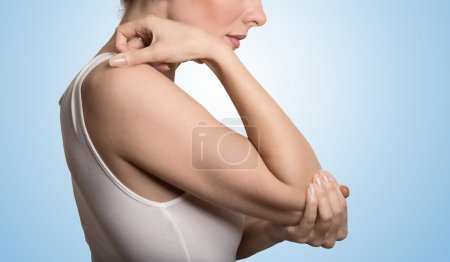 Arm pain and injury concept. Closeup side profile woman with painful elbow