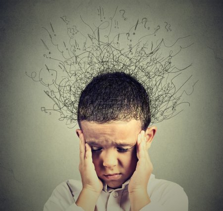 Photo for Closeup sad boy with worried stressed face expression looking down with brain melting into lines question marks. Obsessive compulsive, adhd, anxiety disorders concept - Royalty Free Image