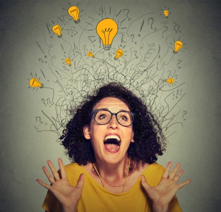 excited happy screaming woman with many light idea bulbs above head