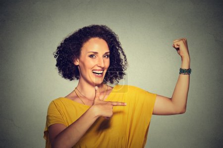 healthy model woman flexing muscles confident showing her strength