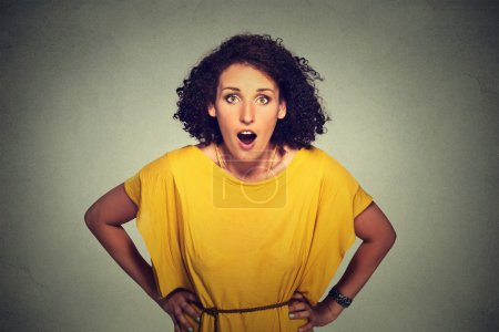 Photo for Surprised woman in yellow dress - Royalty Free Image