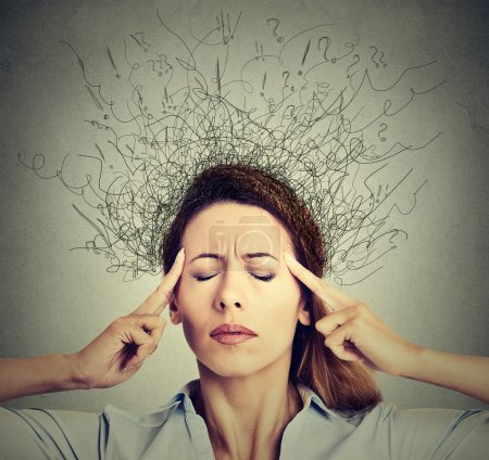 woman with worried stressed face expression eyes closed trying to concentrate