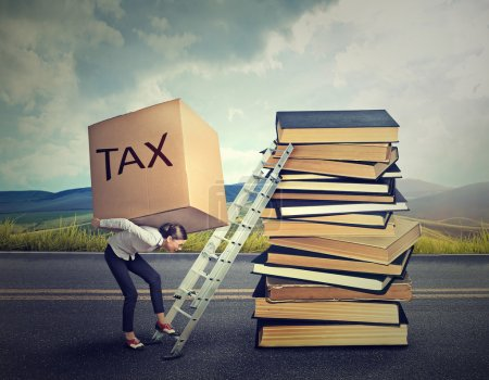 Tax debt concept. Woman with heavy box full of tax debt carrying it up career ladder