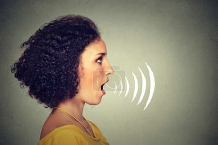 Side profile young woman talking with sound waves coming out of her mouth
