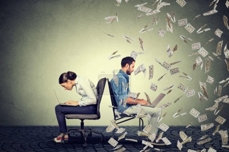 Employee compensation economy concept. Woman working on laptop sitting next to man under money rain.