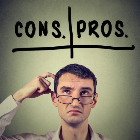 pros and cons, for and against argument concept. Man with glasses looking up deciding