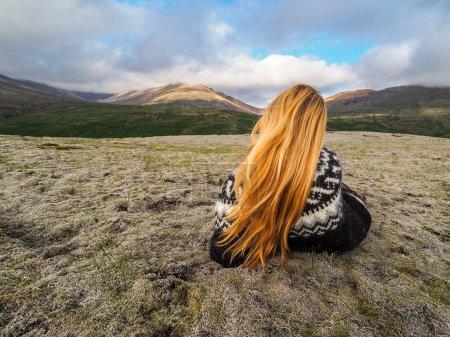 Scandinavian woman wearing patterned knitwear