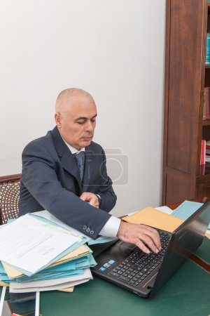 A business man with your files and paperwork on desk, in office.