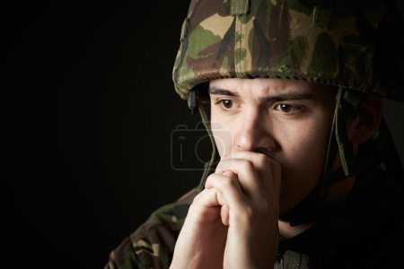 Photo for Soldier In Uniform Suffering From Stress - Royalty Free Image