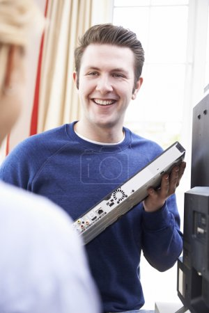 Engineer Giving Advice On Installing Digital TV Equipment