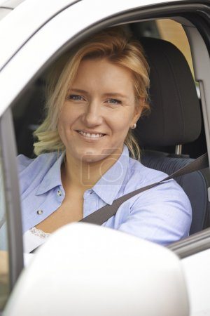 Portrait Of Female Driver Looking Out Of Car Window