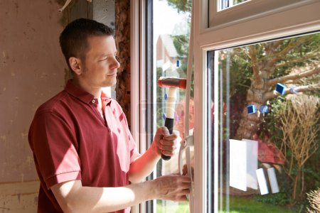 Photo for Construction Worker Installing New Windows In House - Royalty Free Image