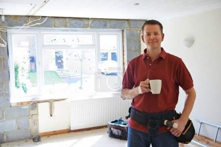Photo for Builder Carrying Out Home Improvements Taking A Break - Royalty Free Image