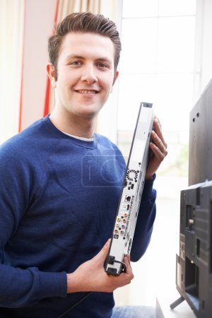 Portrait Of Engineer Installing Digital TV Equipment