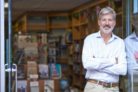 Portrait Of Male Bookshop Owner Outside Store