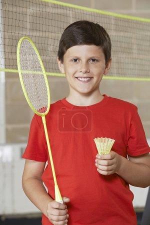 Portrait Of Boy In School Gym Playing Badminton