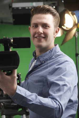 Portrait Of Cameraman Working In Television Studio