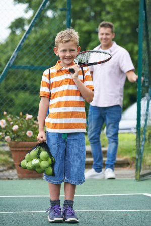 Father Dropping Son Off For Tennis Lesson