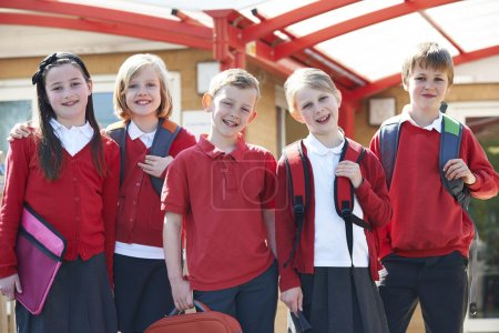 Photo for Portrait Of Schoolchildren Outside Classroom Carrying Bags - Royalty Free Image