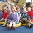 Group Of Pre School Children Answering Question In...