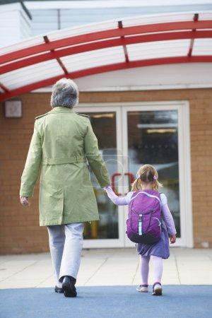 Grandmother Taking Granddaughter To School