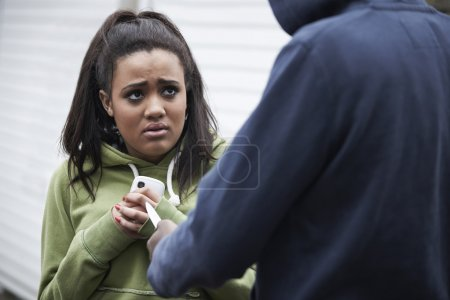 Thief Stealing Teenage Girl's Mobile Phone