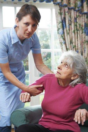 Care Worker Mistreating Elderly Woman