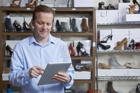Photo for Businessman Running Online Shoe Business With Digital Tablet - Royalty Free Image