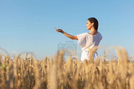 Photo for Girl enjoy with sunshine in wheat field. Young  woman in white dress in wheat field - Royalty Free Image