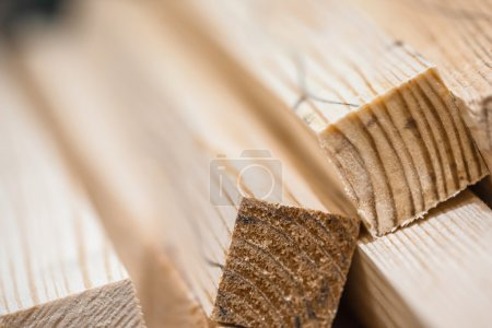 Photo for Wooden beams and planks. Lumber stacked at construction site - Royalty Free Image
