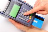 Pomocí platební terminál, zadejte osobní identifikační číslo